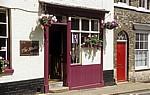 Churchgate Street: Geschäft mit Blumenschmuck - Bury St Edmunds